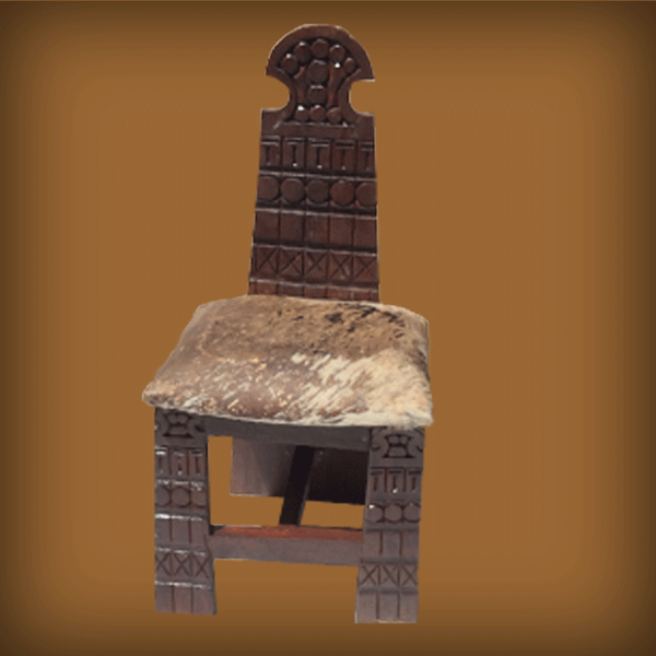 HAND CARVED CHAIR WITH TALL BACK AND SKIN CUSHION